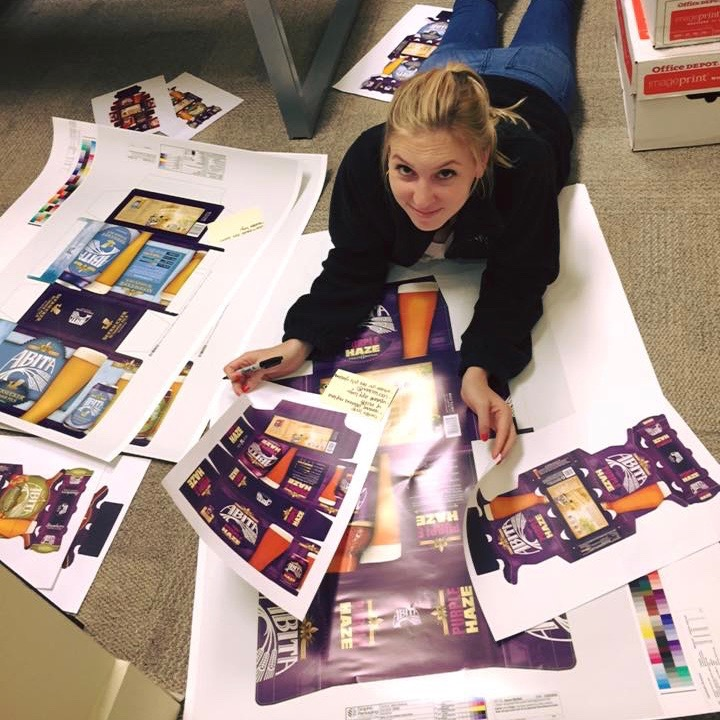 Casey is hard at work proofing some packaging!